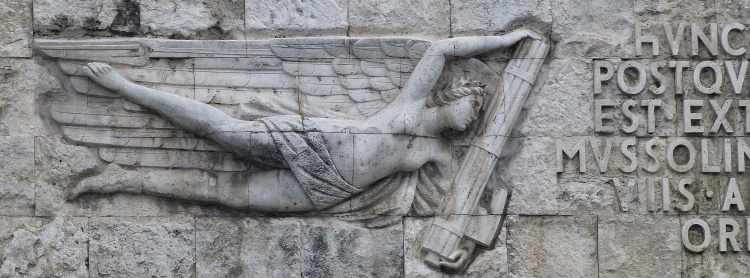 Nike carrying fasces toward Mussolini's name...Fascist architecture near the mausoleum of Augustus.